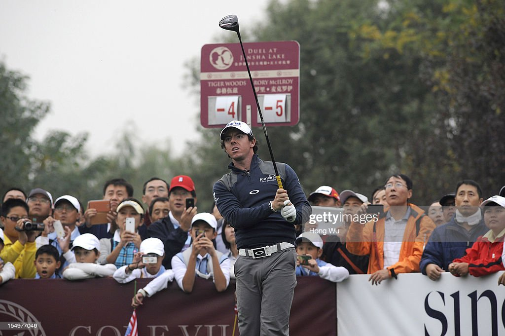 <a gi-track='captionPersonalityLinkClicked' href=/galleries/search?phrase=Rory+McIlroy&family=editorial&specificpeople=783109 ng-click='$event.stopPropagation()'>Rory McIlroy</a> of Northern Ireland in action during the Duel of <a gi-track='captionPersonalityLinkClicked' href=/galleries/search?phrase=Tiger+Woods&family=editorial&specificpeople=157537 ng-click='$event.stopPropagation()'>Tiger Woods</a> and <a gi-track='captionPersonalityLinkClicked' href=/galleries/search?phrase=Rory+McIlroy&family=editorial&specificpeople=783109 ng-click='$event.stopPropagation()'>Rory McIlroy</a> at Jinsha Lake Golf Club on October 29, 2012 in Zhengzhou, China.