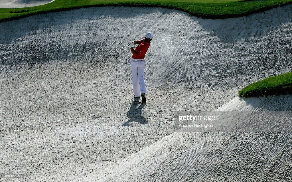 Rory McIlroy of Northern Ireland in action during the final round of the DP World Tour Championship on the Earth Course at Jumeirah Golf Estates on November 25, 2012 in Dubai, United Arab Emirates.