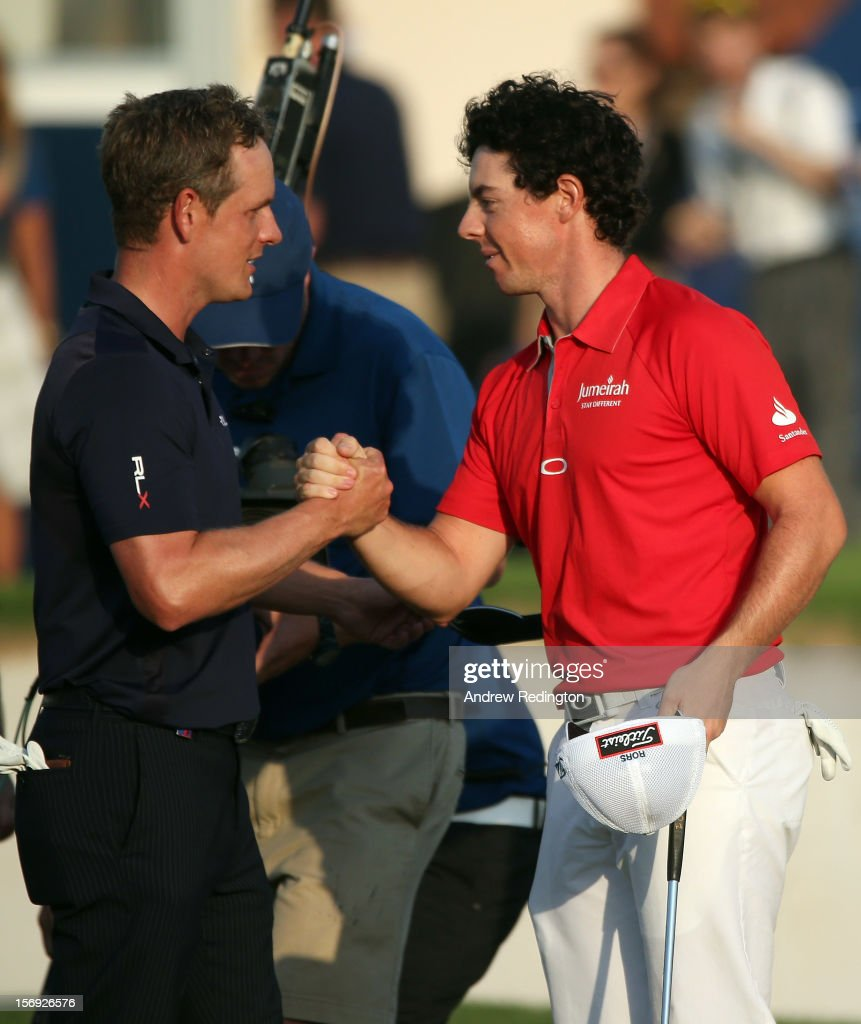 Rory McIlroy of Northern Ireland (right) is congratulated by Luke Donald of Engand (left) on the 18th green after winning the DP World Tour Championship on the Earth Course at Jumeirah Golf Estates on November 25, 2012 in Dubai, United Arab Emirates.