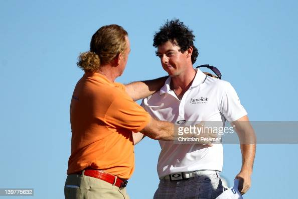 Rory McIlroy of Northern Ireland is congratulated by Miguel Angel Jimenez of Spain after winning their match on the 17th hole during the third round...