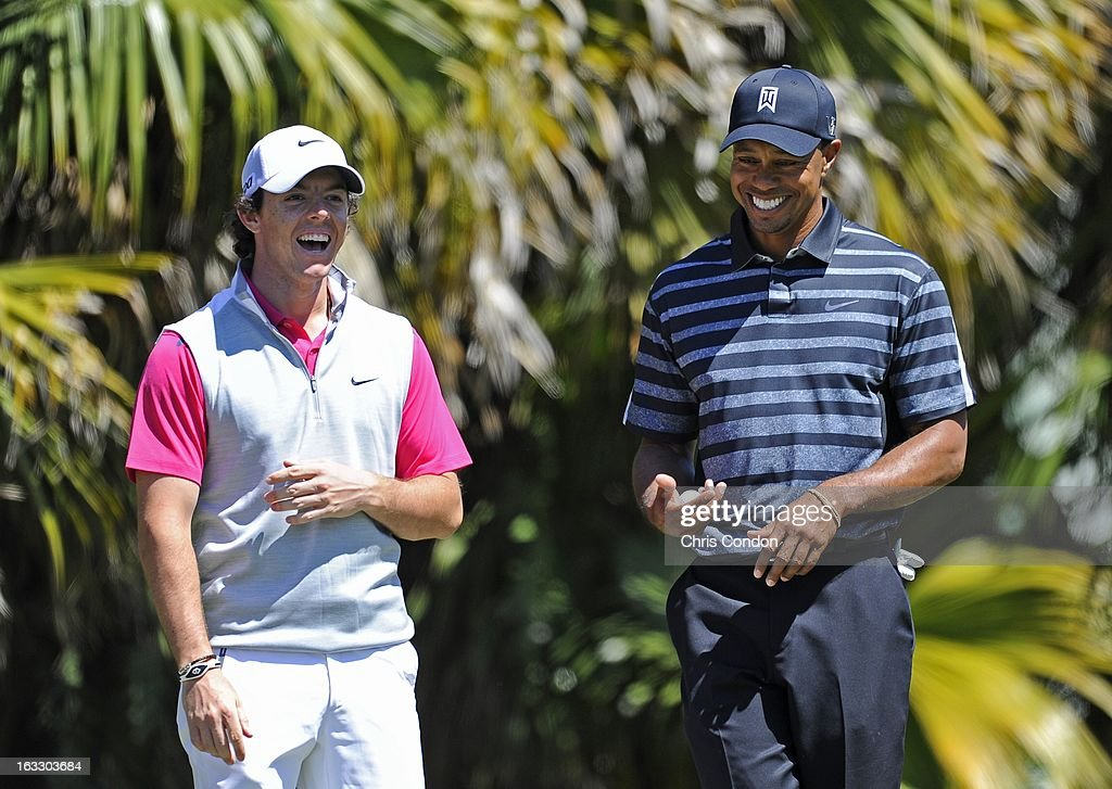 Rory McIlroy of Northern Ireland jokes with Tiger Woods during the first round of the World Golf Championships-Cadillac Championship at TPC Blue Monster at Doral on March 7, 2013 in Doral, Florida.