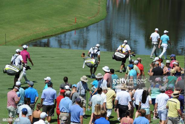 Rory McIlroy of Northern Ireland Justin Thomas and Dustin Johnson walk to the course during the second round of THE PLAYERS Championship on THE...