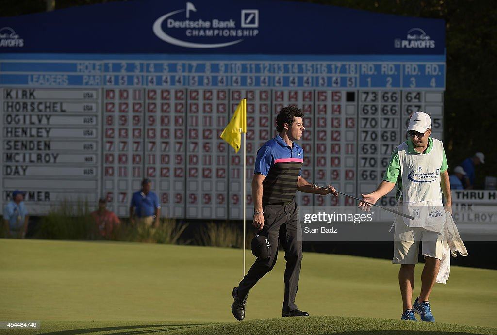 Rory McIlroy of Northern Ireland leaves the 18th green during the final round of the Deutsche Bank Championship at TPC Boston on September 1, 2014 in Norton, Massachusetts.