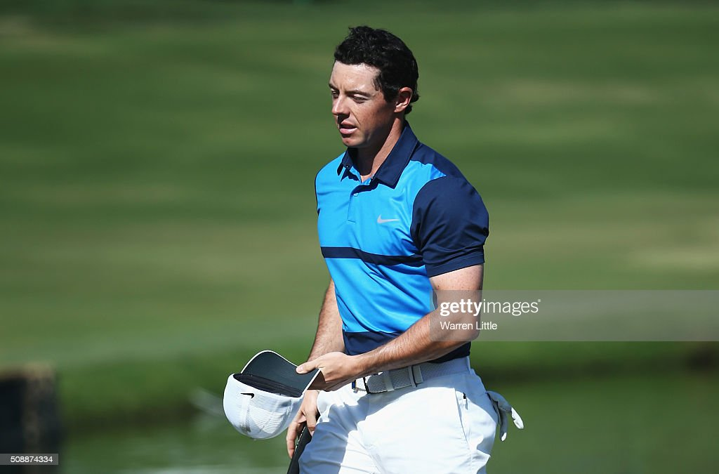 <a gi-track='captionPersonalityLinkClicked' href=/galleries/search?phrase=Rory+McIlroy&family=editorial&specificpeople=783109 ng-click='$event.stopPropagation()'>Rory McIlroy</a> of Northern Ireland leaves the 18th green during the final round of the Omega Dubai Desert Classic at the Emirates Golf Club on February 7, 2016 in Dubai, United Arab Emirates.