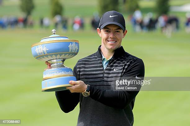 Rory McIlroy of Northern Ireland lifts the Walter Hagen Cup after defeating Gary Woodland 42 in the championship match of the World Golf...
