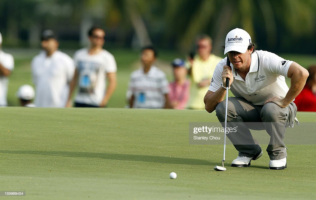 <a gi-track='captionPersonalityLinkClicked' href=/galleries/search?phrase=Rory+McIlroy&family=editorial&specificpeople=783109 ng-click='$event.stopPropagation()'>Rory McIlroy</a> of Northern Ireland lines on the 4th hole during the 3rd round of the Barclays Singapore Open at the Sentosa Golf Club on November 10, 2012 in Singapore.