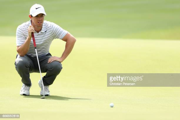 Rory McIlroy of Northern Ireland lines up a putt on the 12th hole of his match during round one of the World Golf ChampionshipsDell Technologies...
