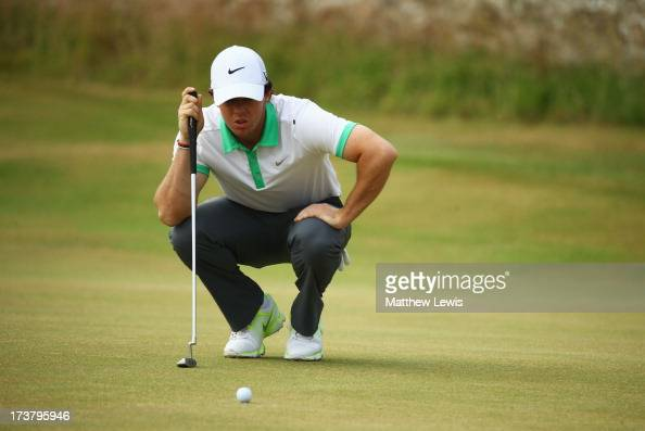 Rory McIlroy of Northern Ireland lines up a putt on the 2nd green during the first round of the 142nd Open Championship at Muirfield on July 18 2013...