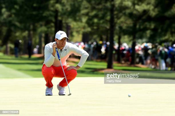 Rory McIlroy of Northern Ireland lines up a putt on the first hole during the third round of the 2017 Masters Tournament at Augusta National Golf...