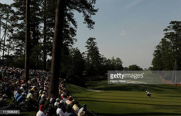 Rory McIlroy of Northern Ireland lines up a putt on the tenth green during the third round of the 2011 Masters Tournament at Augusta National Golf...