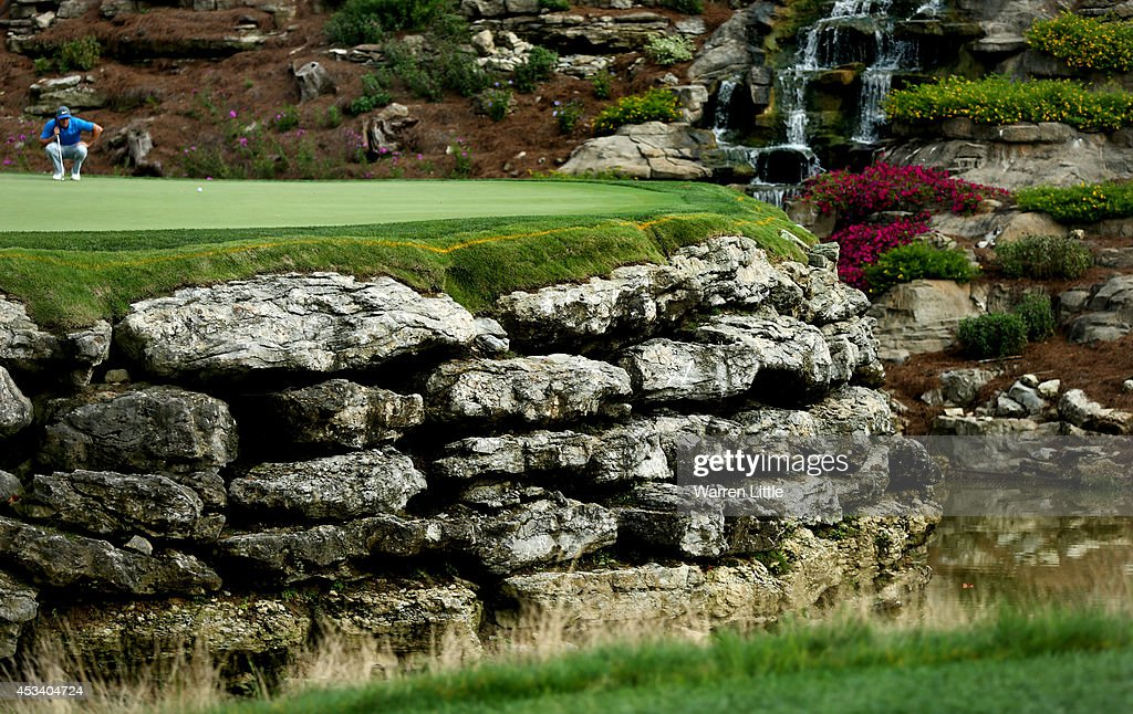 <a gi-track='captionPersonalityLinkClicked' href=/galleries/search?phrase=Rory+McIlroy&family=editorial&specificpeople=783109 ng-click='$event.stopPropagation()'>Rory McIlroy</a> of Northern Ireland lines up his putt on the 13th green during the third round of the 96th PGA Championship at Valhalla Golf Club on August 9, 2014 in Louisville, Kentucky.