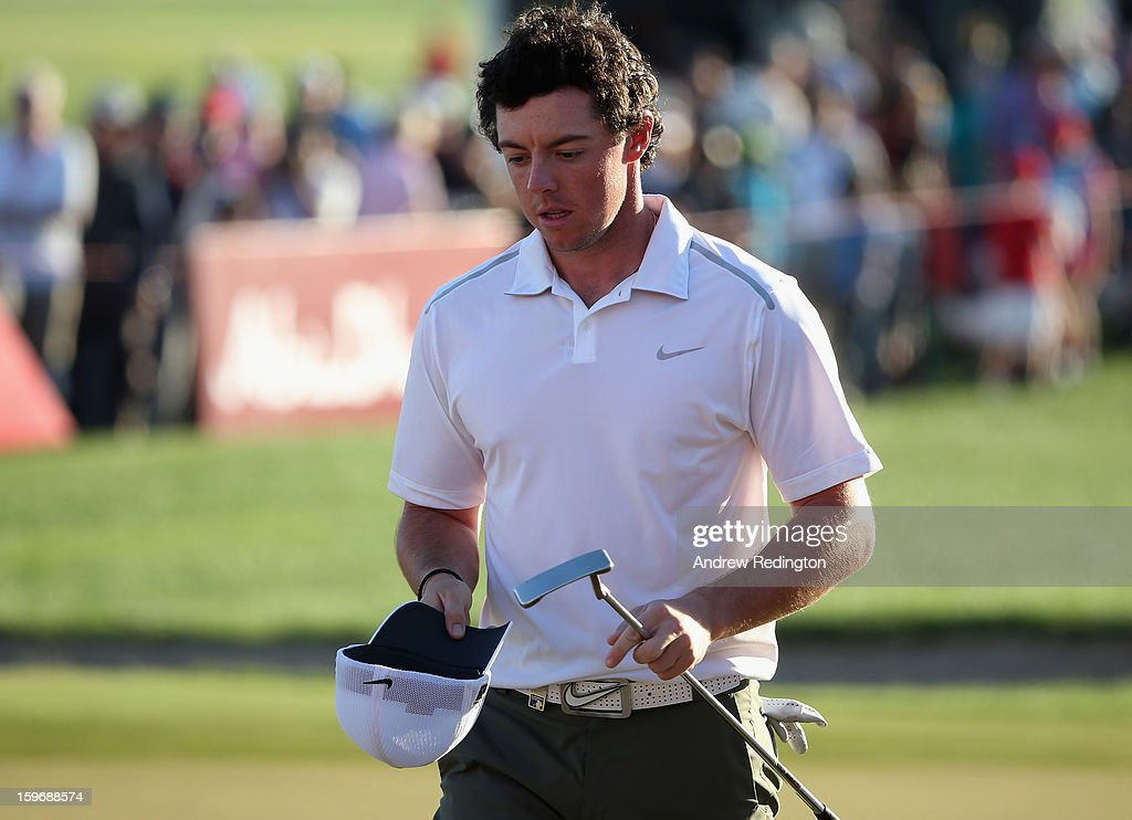 Rory McIlroy of Northern Ireland looks dejected on the 18th green after missing the cut during the second round of The Abu Dhabi HSBC Golf Championship at Abu Dhabi Golf Club on January 18, 2013 in Abu Dhabi, United Arab Emirates.
