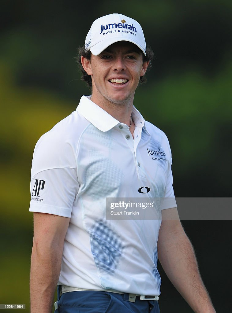 <a gi-track='captionPersonalityLinkClicked' href=/galleries/search?phrase=Rory+McIlroy&family=editorial&specificpeople=783109 ng-click='$event.stopPropagation()'>Rory McIlroy</a> of Northern Ireland looks happy during the continuation of the weather delayed first round of the Barclays Singapore Open at the Sentosa Golf Club on November 9, 2012 in Singapore.