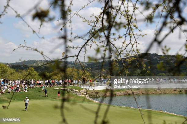 Rory McIlroy of Northern Ireland looks on from the green of the 11th hole of his match during round one of the World Golf ChampionshipsDell...