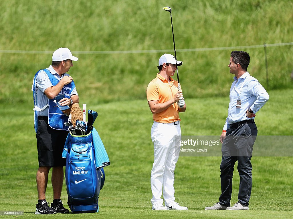 <a gi-track='captionPersonalityLinkClicked' href=/galleries/search?phrase=Rory+McIlroy&family=editorial&specificpeople=783109 ng-click='$event.stopPropagation()'>Rory McIlroy</a> of Northern Ireland looks on with his caddie <a gi-track='captionPersonalityLinkClicked' href=/galleries/search?phrase=J.P.+Fitzgerald&family=editorial&specificpeople=2288814 ng-click='$event.stopPropagation()'>J.P. Fitzgerald</a> and agent Sean O'Flaherty during a pro-am round ahead of the 100th Open de France at Le Golf National on June 29, 2016 in Paris, France.