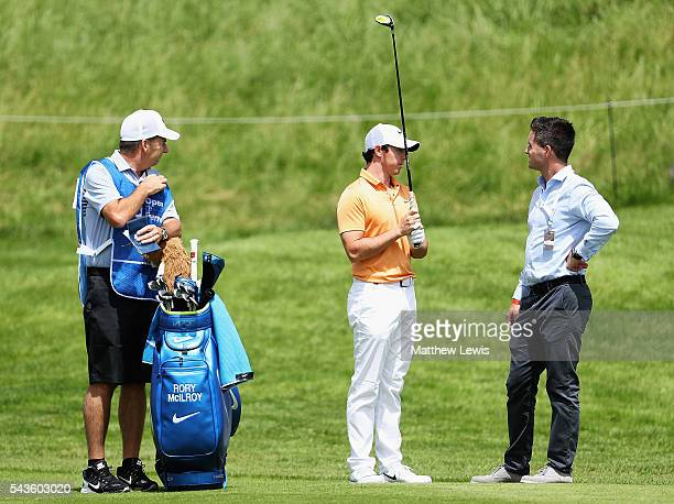 Rory McIlroy of Northern Ireland looks on with his caddie JP Fitzgerald and agent Sean O'Flaherty during a proam round ahead of the 100th Open de...