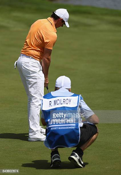 Rory McIlroy of Northern Ireland looks on with his caddie JP Fitzgerald during a proam round ahead of the 100th Open de France at Le Golf National on...