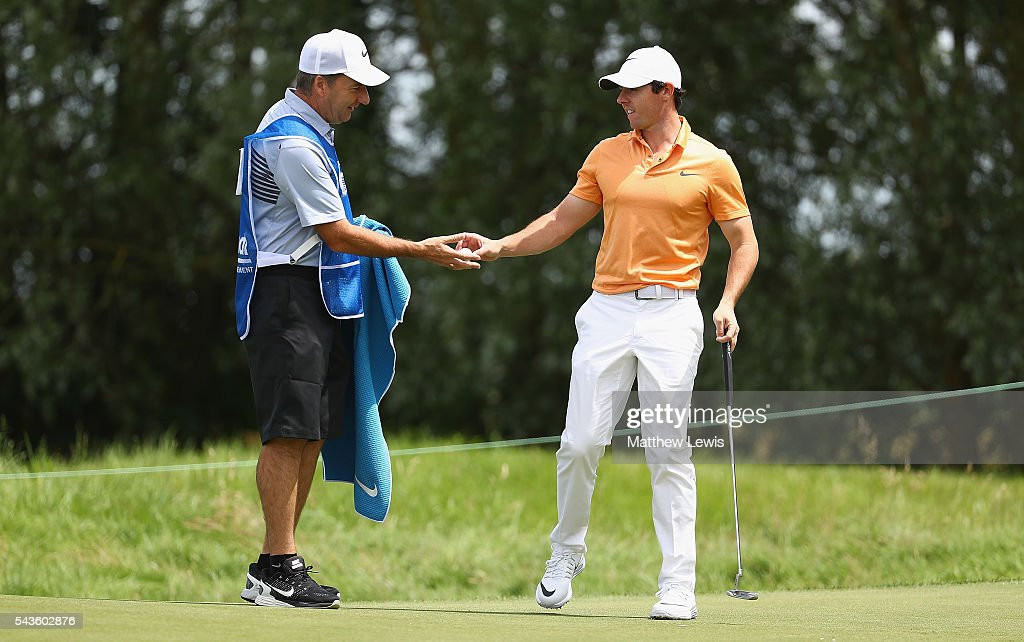 <a gi-track='captionPersonalityLinkClicked' href=/galleries/search?phrase=Rory+McIlroy&family=editorial&specificpeople=783109 ng-click='$event.stopPropagation()'>Rory McIlroy</a> of Northern Ireland looks on with his caddie <a gi-track='captionPersonalityLinkClicked' href=/galleries/search?phrase=J.P.+Fitzgerald&family=editorial&specificpeople=2288814 ng-click='$event.stopPropagation()'>J.P. Fitzgerald</a> during a pro-am round ahead of the 100th Open de France at Le Golf National on June 29, 2016 in Paris, France.