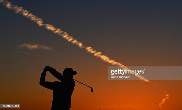 Rory McIlroy of Northern Ireland on the practice range during the first round of the Abu Dhabi HSBC Golf Championship at the Abu Dhabi Golf Club on...