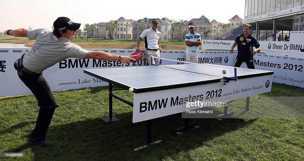 <a gi-track='captionPersonalityLinkClicked' href=/galleries/search?phrase=Rory+McIlroy&family=editorial&specificpeople=783109 ng-click='$event.stopPropagation()'>Rory McIlroy</a> of Northern Ireland playing table tennis against <a gi-track='captionPersonalityLinkClicked' href=/galleries/search?phrase=Timo+Boll&family=editorial&specificpeople=204430 ng-click='$event.stopPropagation()'>Timo Boll</a> of Germany during the photocall prior the start of the BMW Masters at the Lake Malaren Golf Club on October 23, 2012 in Shanghai, China.