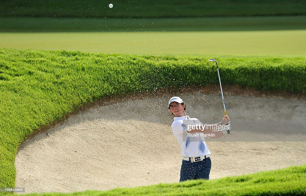 <a gi-track='captionPersonalityLinkClicked' href=/galleries/search?phrase=Rory+McIlroy&family=editorial&specificpeople=783109 ng-click='$event.stopPropagation()'>Rory McIlroy</a> of Northern Ireland plays a bunker shot during the continuation of the weather delayed first round of the Barclays Singapore Open at the Sentosa Golf Club on November 9, 2012 in Singapore.