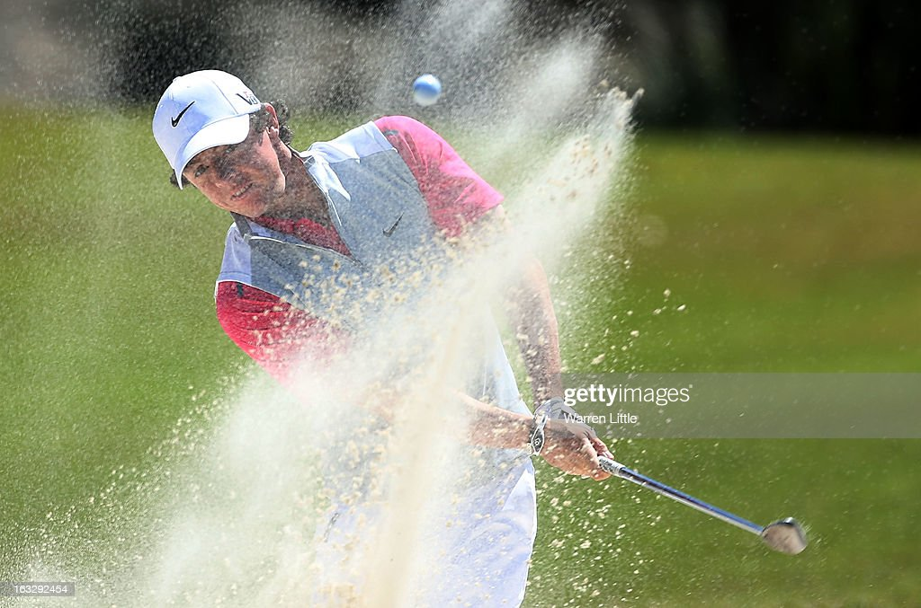 <a gi-track='captionPersonalityLinkClicked' href=/galleries/search?phrase=Rory+McIlroy&family=editorial&specificpeople=783109 ng-click='$event.stopPropagation()'>Rory McIlroy</a> of Northern Ireland plays a bunker shot on the 12th hole during the first round of the WGC-Cadillac Championship at the Trump Doral Golf Resort & Spa in Miami, Florida.