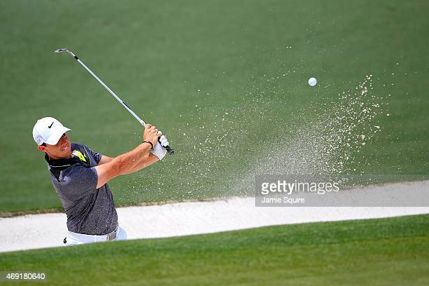 Rory McIlroy of Northern Ireland plays a bunker shot on the second hole during the second round of the 2015 Masters Tournament at Augusta National...