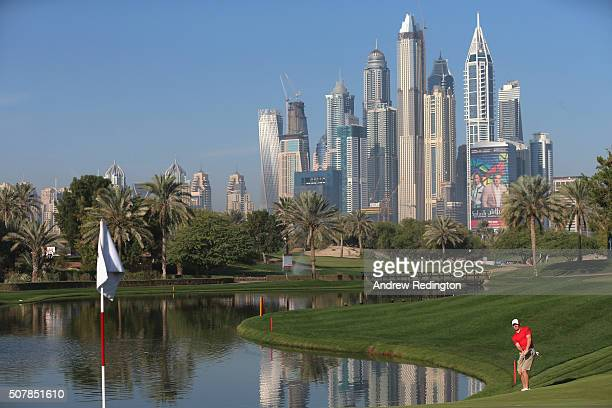 Rory McIlroy of Northern Ireland plays a chip shot on the fourth hole during practice for the 2016 Omega Dubai Desert Classic on the Majlis Course at...