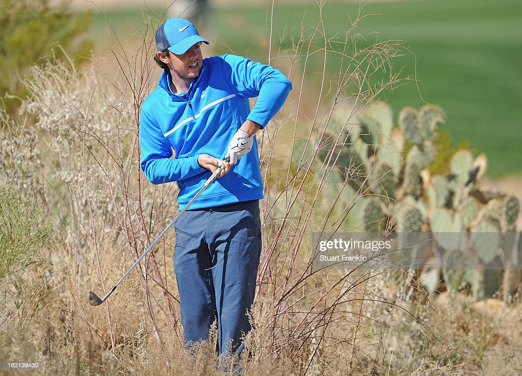 Rory McIlroy of Northern Ireland plays a shot during practice prior to the start of the World Golf ChampionshipsAccenture Match Play Championship at...