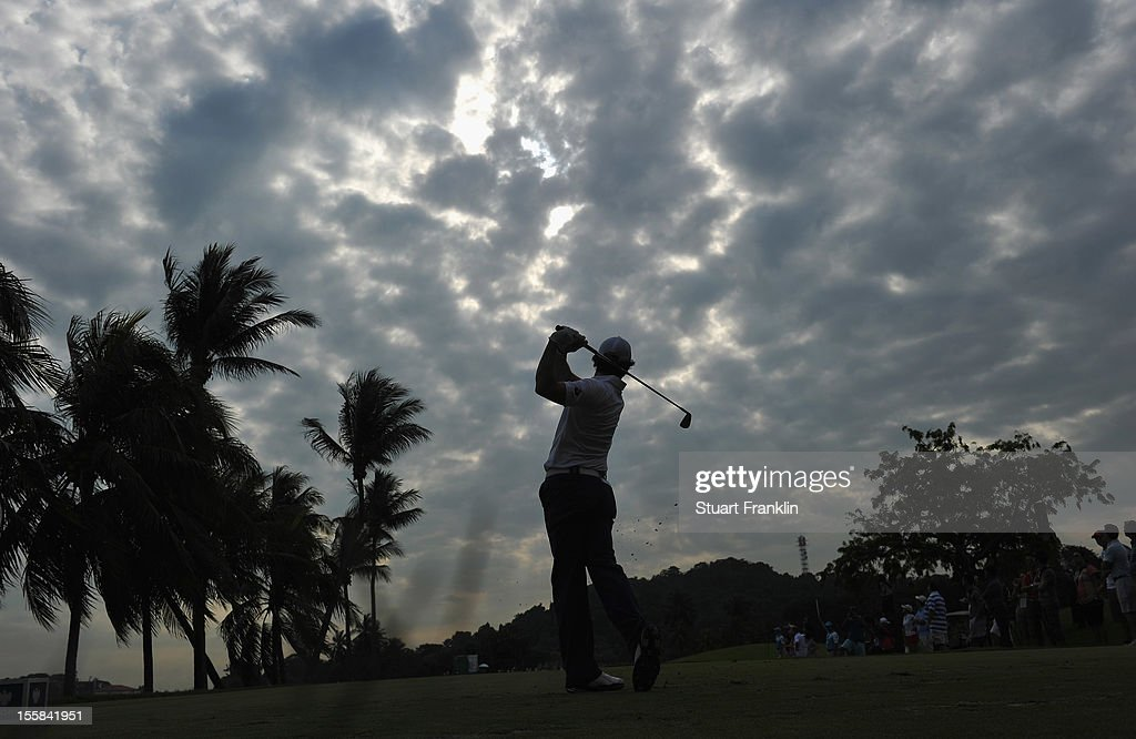 <a gi-track='captionPersonalityLinkClicked' href=/galleries/search?phrase=Rory+McIlroy&family=editorial&specificpeople=783109 ng-click='$event.stopPropagation()'>Rory McIlroy</a> of Northern Ireland plays a shot during the continuation of the weather delayed first round of the Barclays Singapore Open at the Sentosa Golf Club on November 9, 2012 in Singapore.