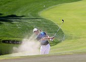 TOPSHOT Rory McIlroy of Northern Ireland plays a shot during the final round of the 2016 Dubai Desert Classic at the Emirates Golf Club in Dubai on...