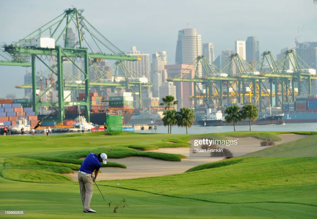 <a gi-track='captionPersonalityLinkClicked' href=/galleries/search?phrase=Rory+McIlroy&family=editorial&specificpeople=783109 ng-click='$event.stopPropagation()'>Rory McIlroy</a> of Northern Ireland plays a shot during the resumption of the rain delayed second round of the Barclays Singapore Open at the Sentosa Golf Club on November 10, 2012 in Singapore.