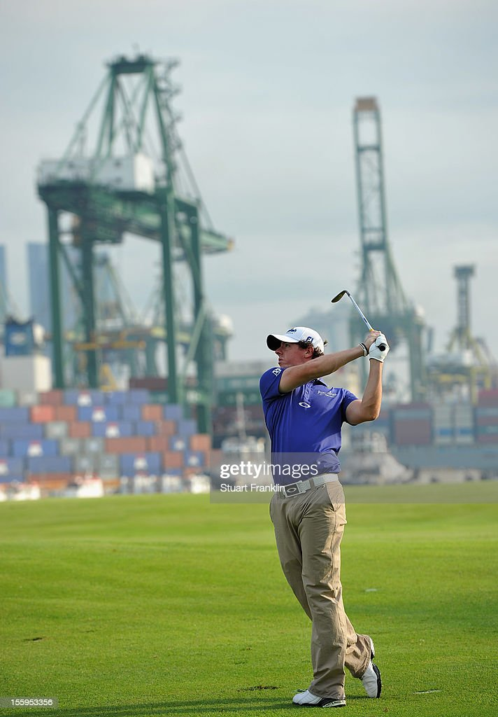 Rory McIlroy of Northern Ireland plays a shot during the resumption of the rain delayed second round of the Barclays Singapore Open at the Sentosa Golf Club on November 10, 2012 in Singapore.