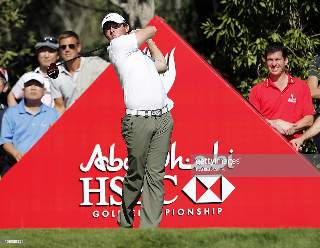 Rory McIlroy of Northern Ireland plays a shot during the second round of the Abu Dhabi Golf Championship at the Abu Dhabi Golf Club in the Emirati capital on January 18, 2013. McIlroy finished well outside the cut line, while playing partner Tiger Woods appeared to have made it into the weekend before he was hit with a two-stroke penalty for a rules infringement that appeared to end his challenge.