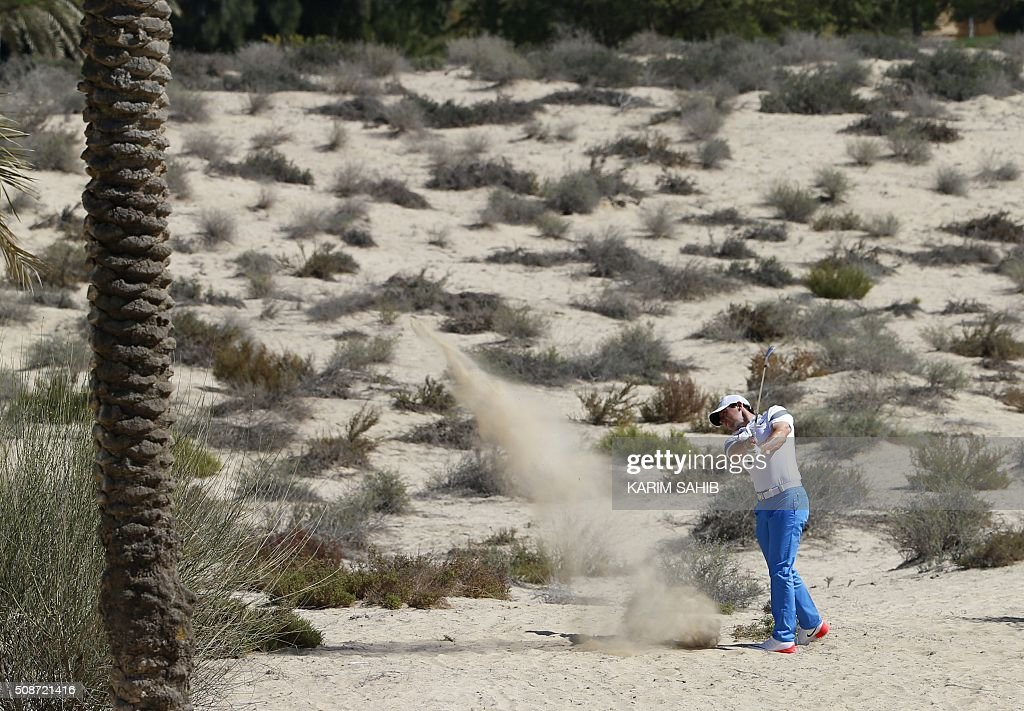 Rory McIlroy of Northern Ireland plays a shot during the third round of the 2016 Dubai Desert Classic at the Emirates Golf Club in Dubai on February 6, 2016. / AFP / KARIM SAHIB