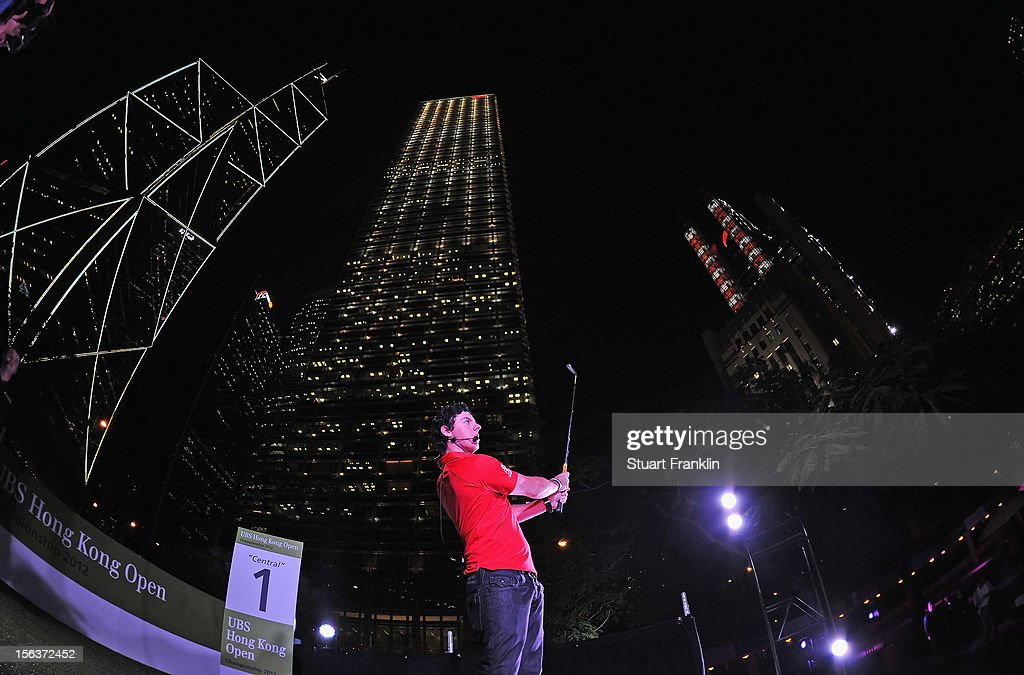 <a gi-track='captionPersonalityLinkClicked' href=/galleries/search?phrase=Rory+McIlroy&family=editorial&specificpeople=783109 ng-click='$event.stopPropagation()'>Rory McIlroy</a> of Northern Ireland plays a shot during the urban golf challenge prior to the start of the UBS Hong Kong open at charter gardens on November 14, 2012 in Hong Kong, Hong Kong.