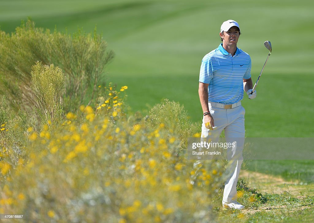 <a gi-track='captionPersonalityLinkClicked' href=/galleries/search?phrase=Rory+McIlroy&family=editorial&specificpeople=783109 ng-click='$event.stopPropagation()'>Rory McIlroy</a> of Northern Ireland plays a shot on the 13th hole during the second round of the World Golf Championships - Accenture Match Play Championship at The Golf Club at Dove Mountain on February 20, 2014 in Marana, Arizona.