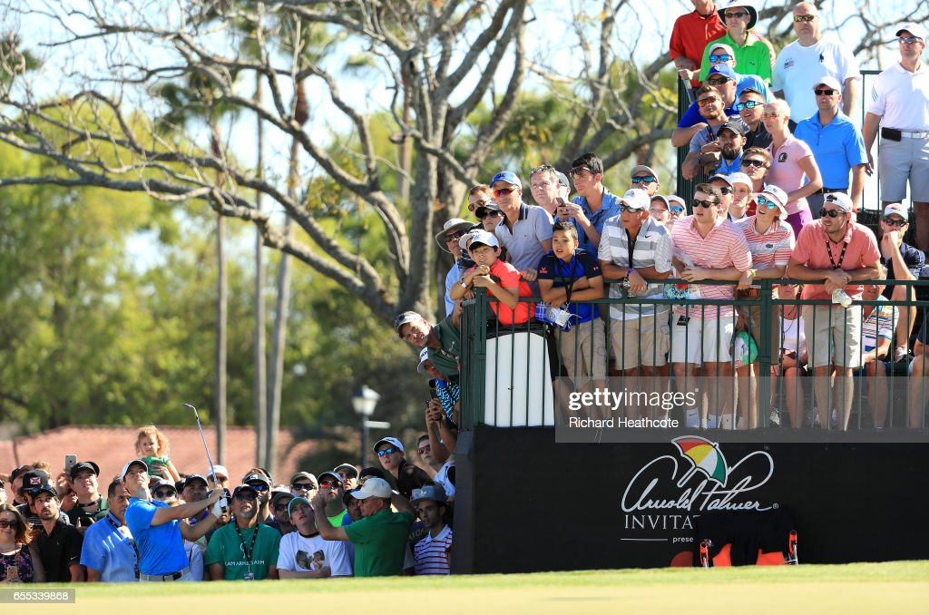 Rory McIlroy of Northern Ireland plays a shot on the 14th hole during the final round of the Arnold Palmer Invitational Presented By MasterCard at Bay Hill Club and Lodge on March 19, 2017 in Orlando, Florida.