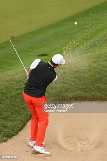 Rory McIlroy of Northern Ireland plays a shot out of a bunker on the 2nd hole of his match during round three of the World Golf ChampionshipsDell...
