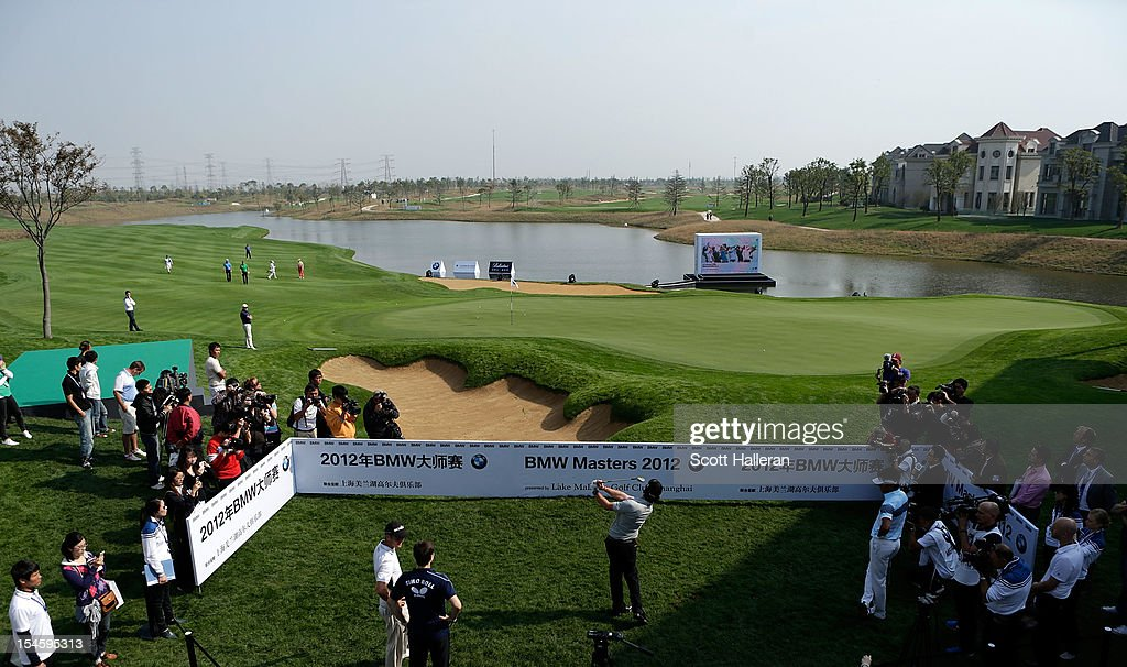 <a gi-track='captionPersonalityLinkClicked' href=/galleries/search?phrase=Rory+McIlroy&family=editorial&specificpeople=783109 ng-click='$event.stopPropagation()'>Rory McIlroy</a> of Northern Ireland plays a shot to the 18th green during the photocall and press conference prior to the start of the BMW Masters at the Lake Malaren Golf Club on October 23, 2012 in Shanghai, China.