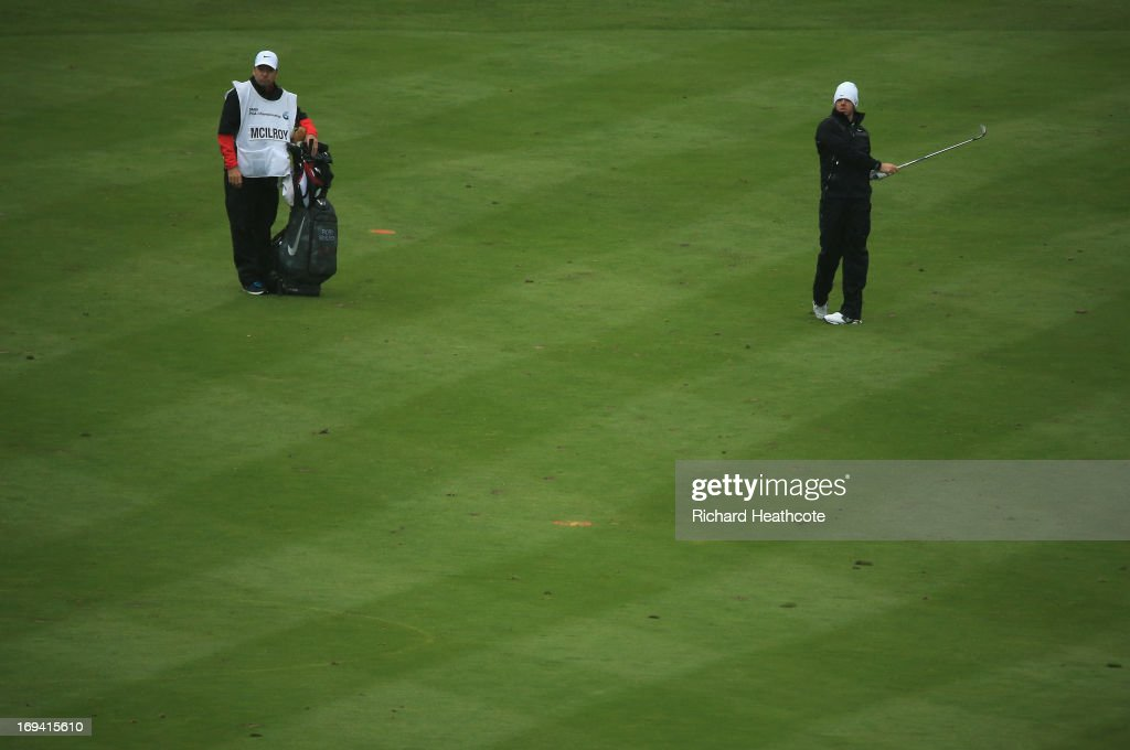 <a gi-track='captionPersonalityLinkClicked' href=/galleries/search?phrase=Rory+McIlroy&family=editorial&specificpeople=783109 ng-click='$event.stopPropagation()'>Rory McIlroy</a> of Northern Ireland plays an approach on the eighteenth fairway during the second round of the BMW PGA Championship on the West Course at Wentworth on May 24, 2013 in Virginia Water, England.
