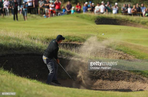 Rory McIlroy of Northern Ireland plays from a bunker on the 10th hole during the third round of the 146th Open Championship at Royal Birkdale on July...