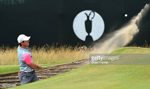 Rory McIlroy of Northern Ireland plays from a bunker on the seventh hole during the final round of The 143rd Open Championship at Royal Liverpool on...