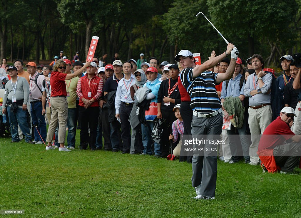 Rory McIlroy of Northern Ireland plays from the rough at the 13th hole before finishing equal second on day two of the WGC-HSBC Champions tournament at the Shanghai Sheshan International Golf Club on November 1, 2013. McIlroy finished the day on 7 under par. AFP PHOTO/Mark RALSTON