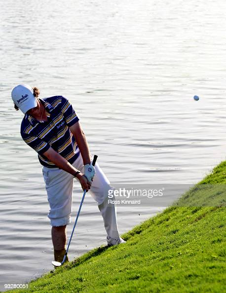 Rory McIlroy of Northern Ireland plays from the water on the 16th hole during the third round of the Dubai World Championship on the Earth Course...