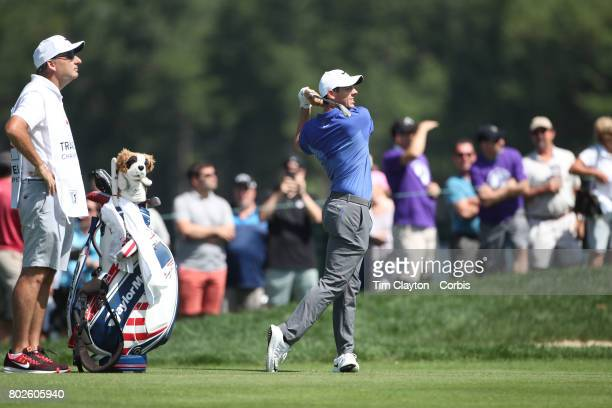 Rory McIlroy of Northern Ireland plays his approach shot to the ninth during the fourth round of the Travelers Championship Tournament at the TPC...