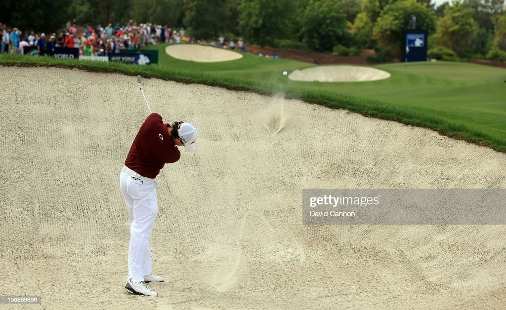 <a gi-track='captionPersonalityLinkClicked' href=/galleries/search?phrase=Rory+McIlroy&family=editorial&specificpeople=783109 ng-click='$event.stopPropagation()'>Rory McIlroy</a> of Northern Ireland plays his second shot at the par 4, 1st hole during the third round of the 2012 DP World Tour Championship on the Earth Course at Jumeirah Golf Estates on November 24, 2012 in Dubai, United Arab Emirates.