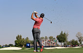 Rory McIlroy of Northern Ireland plays his second shot at the par 4 ninth hole during the third round of the 2014 DP World Tour Championship at...