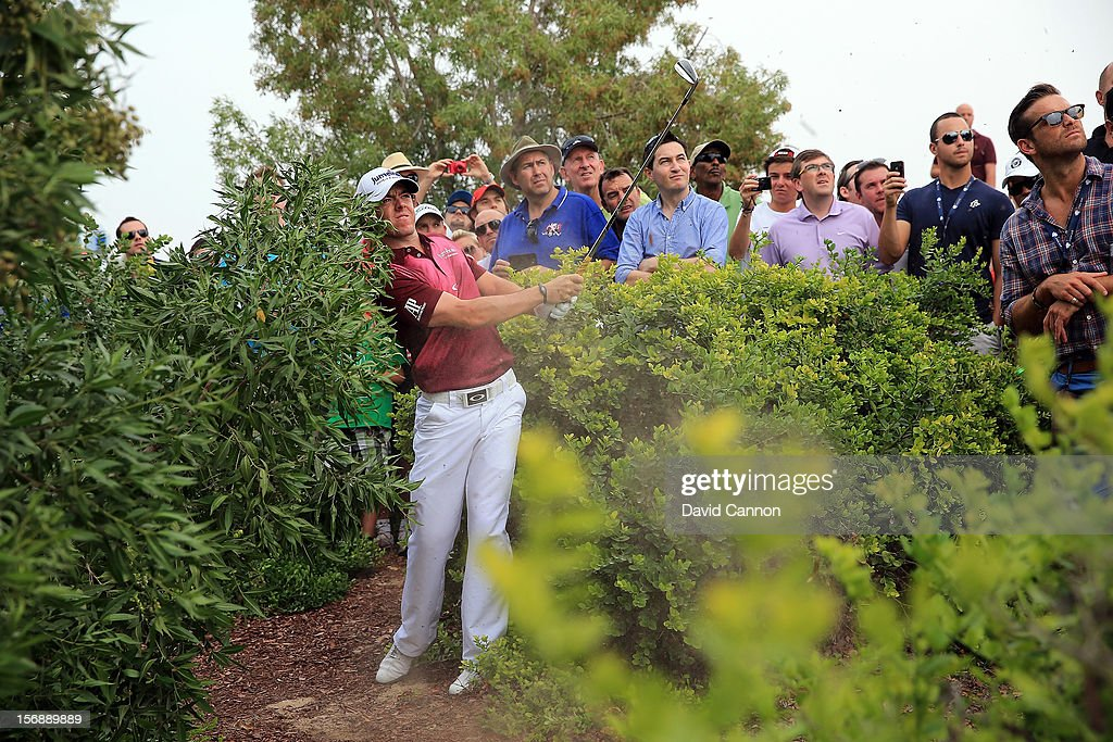 <a gi-track='captionPersonalityLinkClicked' href=/galleries/search?phrase=Rory+McIlroy&family=editorial&specificpeople=783109 ng-click='$event.stopPropagation()'>Rory McIlroy</a> of Northern Ireland plays his second shot at the par 5, 2nd hole during the third round of the 2012 DP World Tour Championship on the Earth Course at Jumeirah Golf Estates on November 24, 2012 in Dubai, United Arab Emirates.