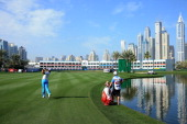 Rory McIlroy of Northern Ireland plays his second shot at the par 5 18th hole during the first round of the 2014 Omega Dubai Desert Classic on the...